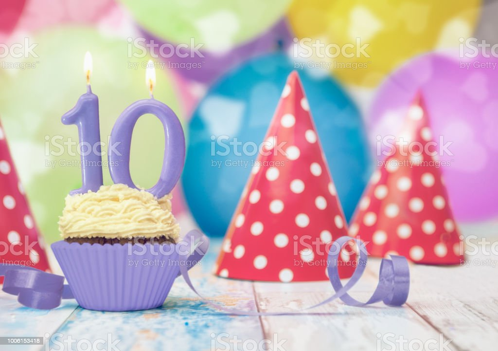 Single Muffin For Tenth Birthday With Party Hats Royalty Free Stock Photo