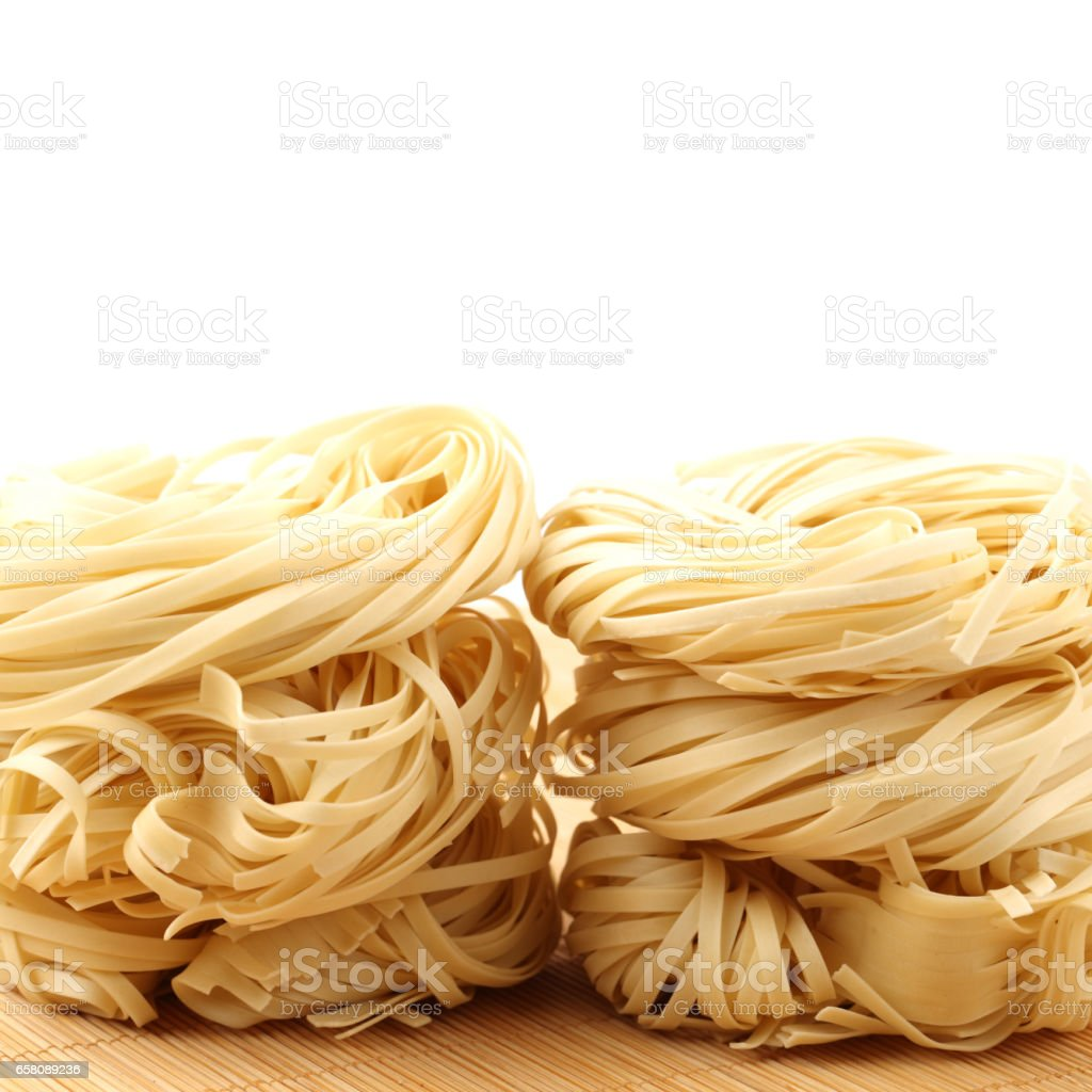 single noodle (Tagliatelle Tower)on white background royalty-free stock photo