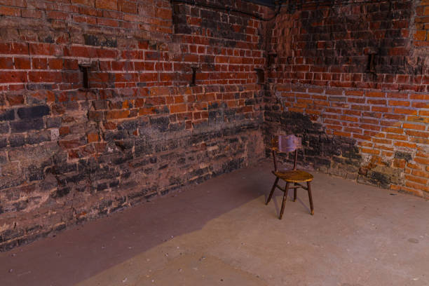Single, old chair against old brick wall – zdjęcie