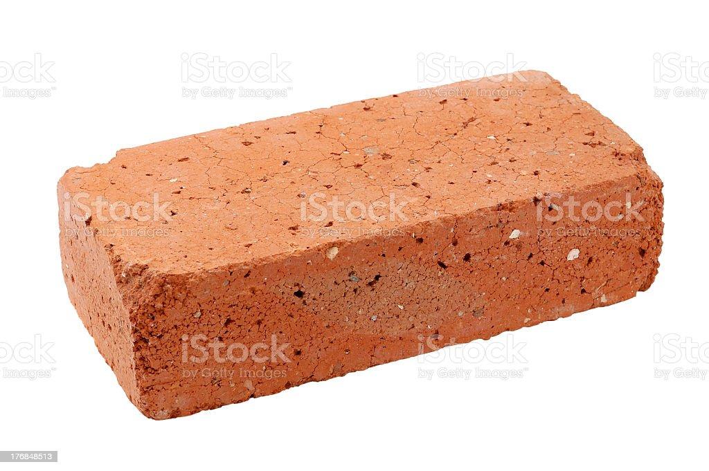 Single old red brick isolated on white background stock photo