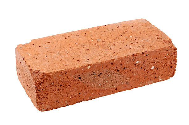 Single old red brick isolated on white background stock photo