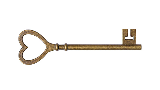 istock Single old vintage door key in the shape of a heart 1149717700