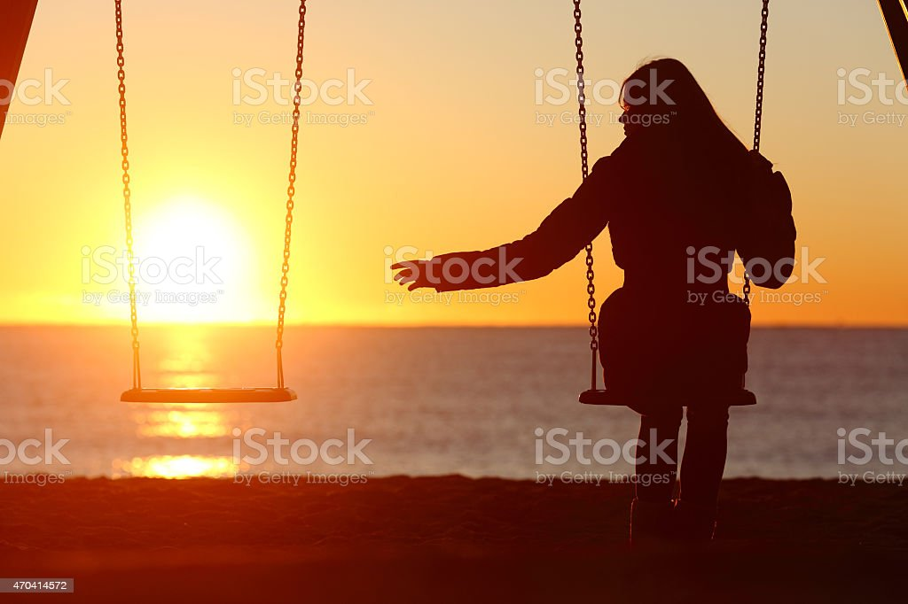 Single or divorced woman alone missing a boyfriend stock photo