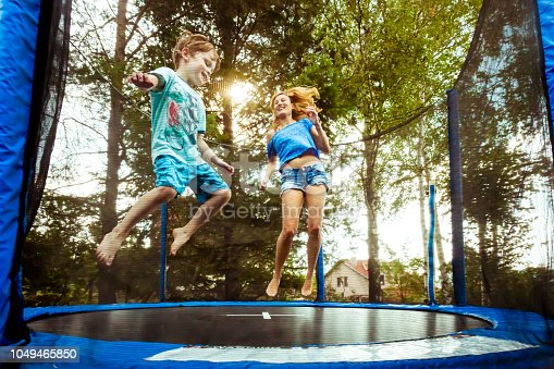 istock Single parent having fun with her son on trampoline 1049465850