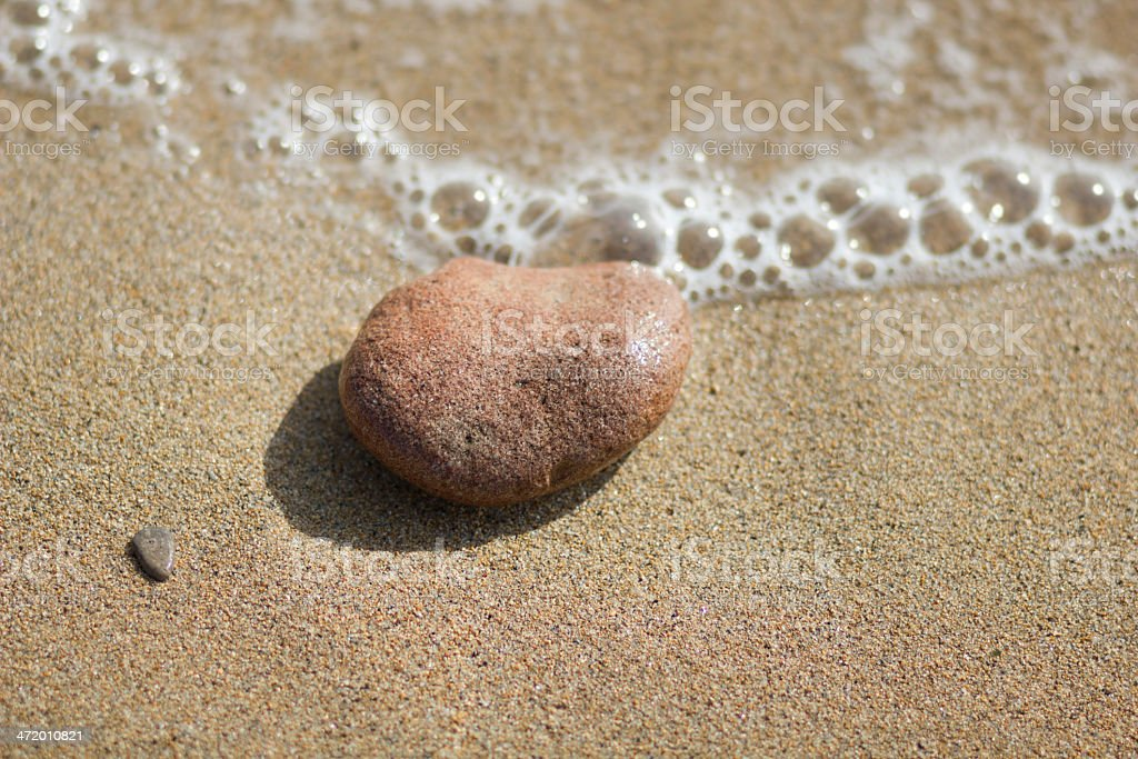 Single pebble on the beach stock photo