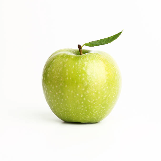 Single perfect green apple on a white background Green apple (isolated with clipping path) granny smith apple stock pictures, royalty-free photos & images