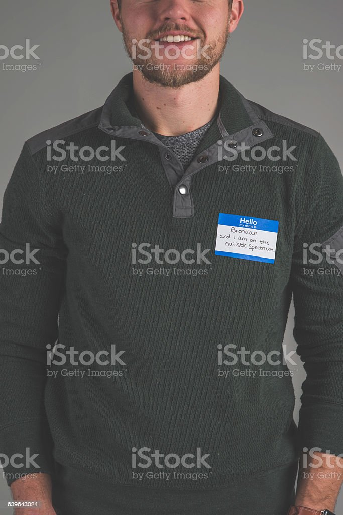 Single person in studio wearing a nametag with a label stock photo
