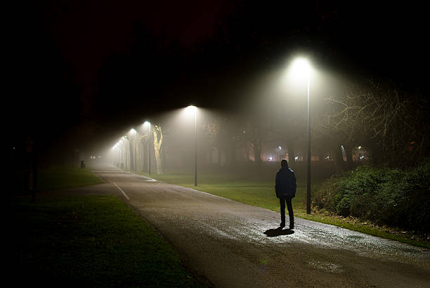 Single Person Walking on Street in the Dark Night - Photo