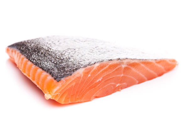 Single piece of salmon isolated on white background real edible food - no artificial ingredients used salmonidae stock pictures, royalty-free photos & images