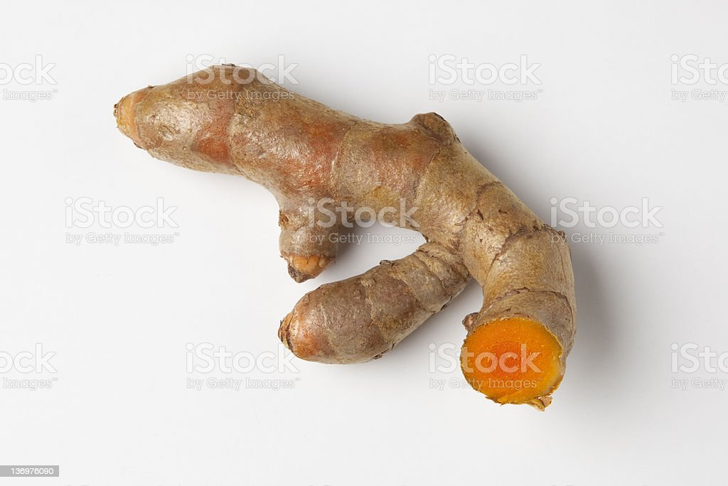 Single piece of Turmeric root spice stock photo