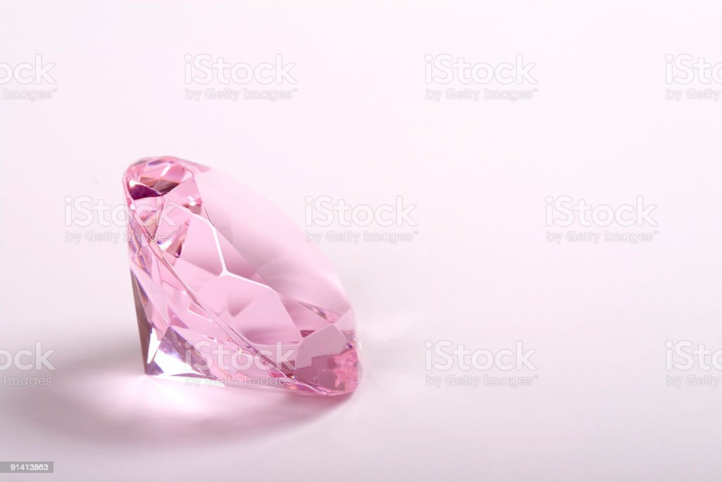 Single pink diamond on white background copyspace right stock photo