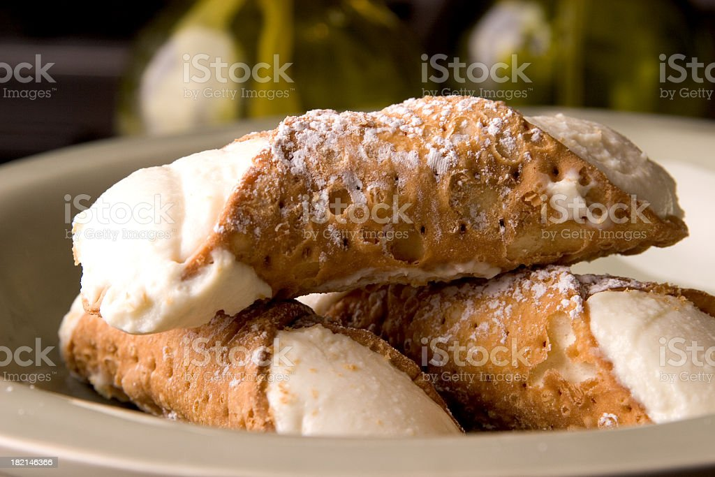 Single portion of fresh, crispy Cannoli desert  stock photo
