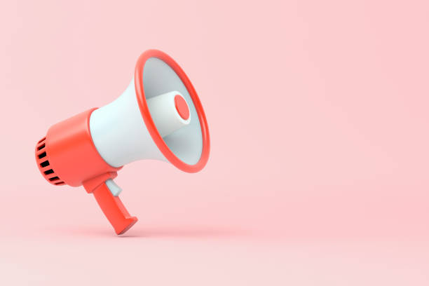 single red and white electric megaphone with a handle stands on a pink background - megafono foto e immagini stock