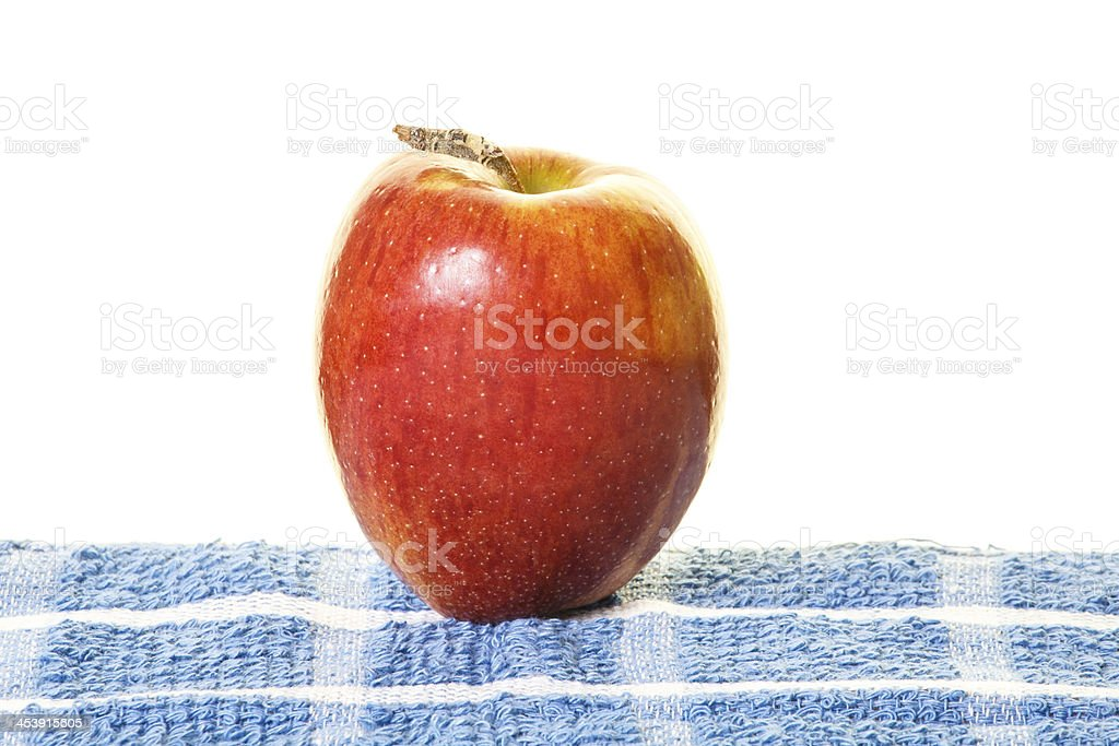 Single Red Apple on Blue Placemat royalty-free stock photo