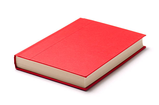 A single red book on a white surface stock photo