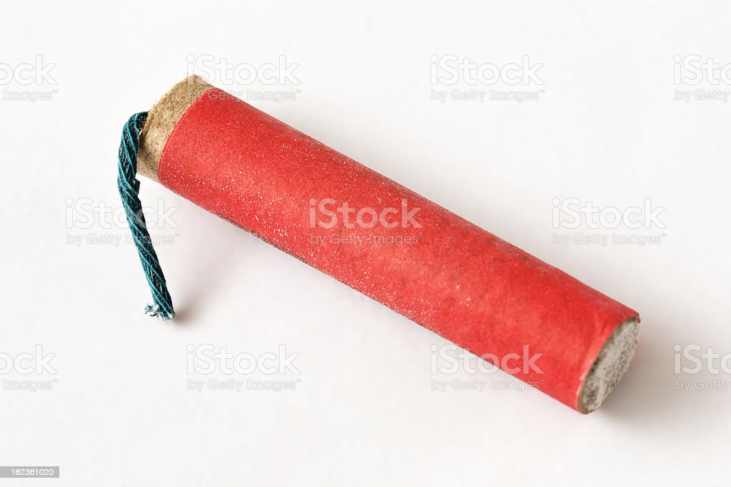 Single red chinese firecracker on a white background close-up royalty-free stock photo