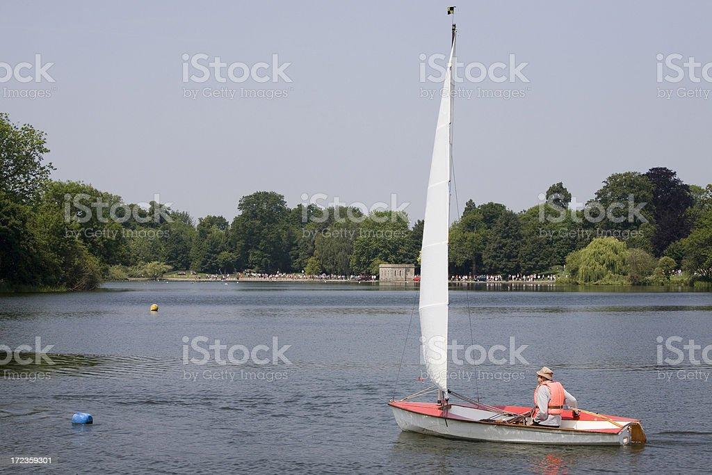 Single red sailing boat royalty-free stock photo