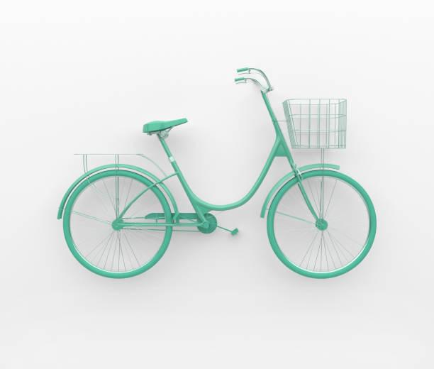 Vélo rétro unique peint en turquoise monochrome. Isolé sur fond blanc. Concept abstrait. - Photo