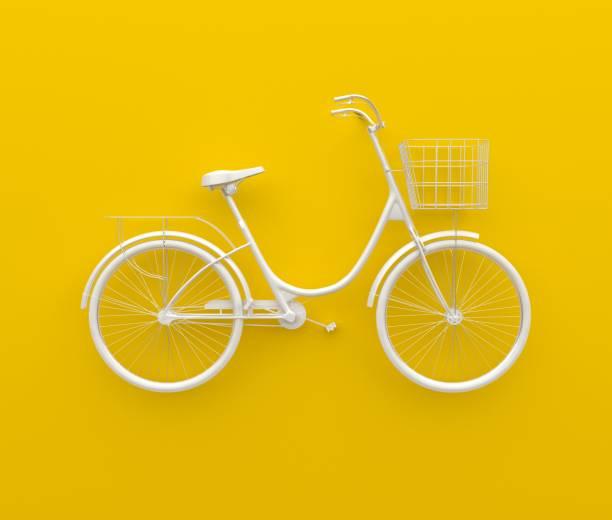 vélo rétro unique peint en camaïeu blanc. isolé sur fond jaune. concept abstrait. - fond couleur uni photos et images de collection
