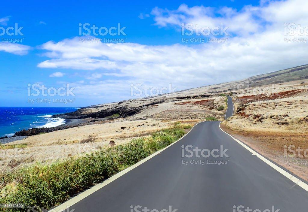 Single Road on Slopes of Volcano with Coastline stock photo