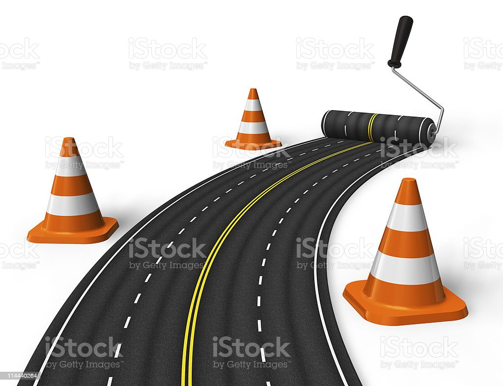 Single road painted on by a rolling brush with orange cones royalty-free stock photo