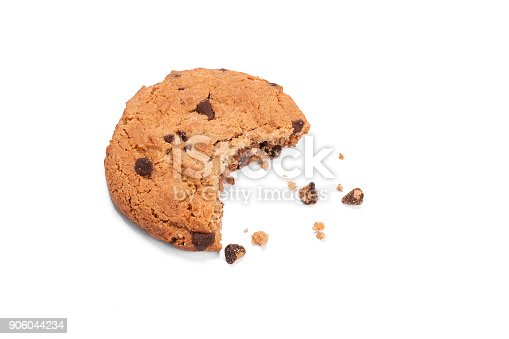 Single round chocolate chip biscuit with crumbs and bite missing, isolated on white from above. Sweet biscuits. Homemade pastry. Chocolate chip cookie.
