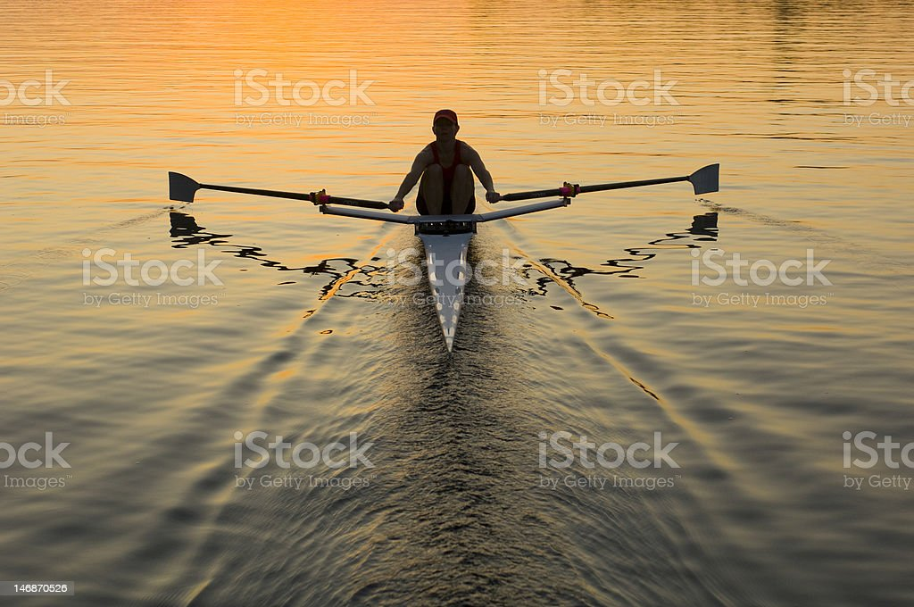 Single Rower In Sunrise stock photo