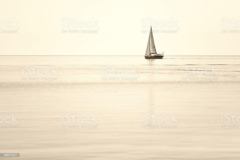 single sailboat on horizon royalty-free stock photo