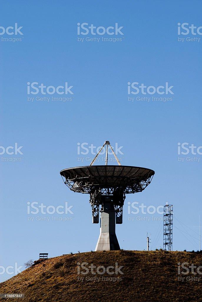 Single Satellite Dish Pointing Skyward stock photo