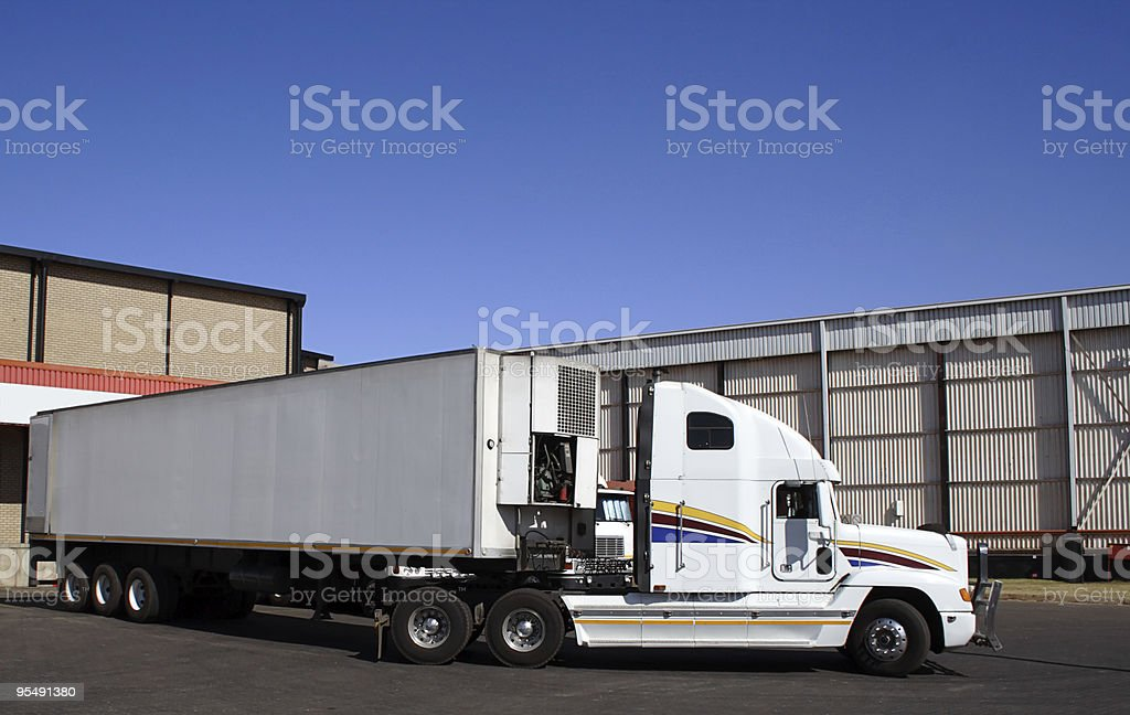 Single semi truck at a distribution goods warehouse stock photo