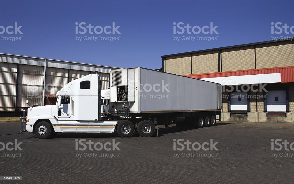 Single semi truck at frozen goods warehouse stock photo