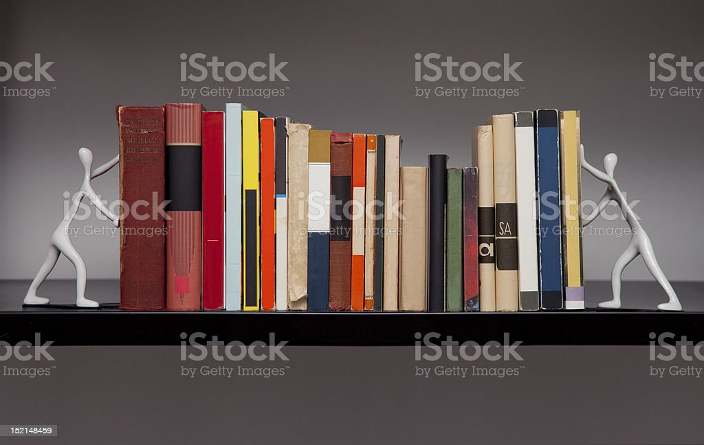 Single shelf of books and bookends royalty-free stock photo