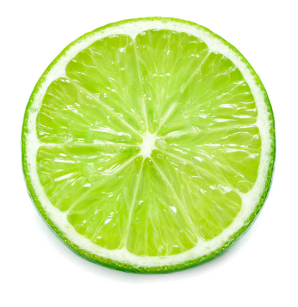 single slice of lime isolated on white background single slice of lime isolated on white background lime stock pictures, royalty-free photos & images
