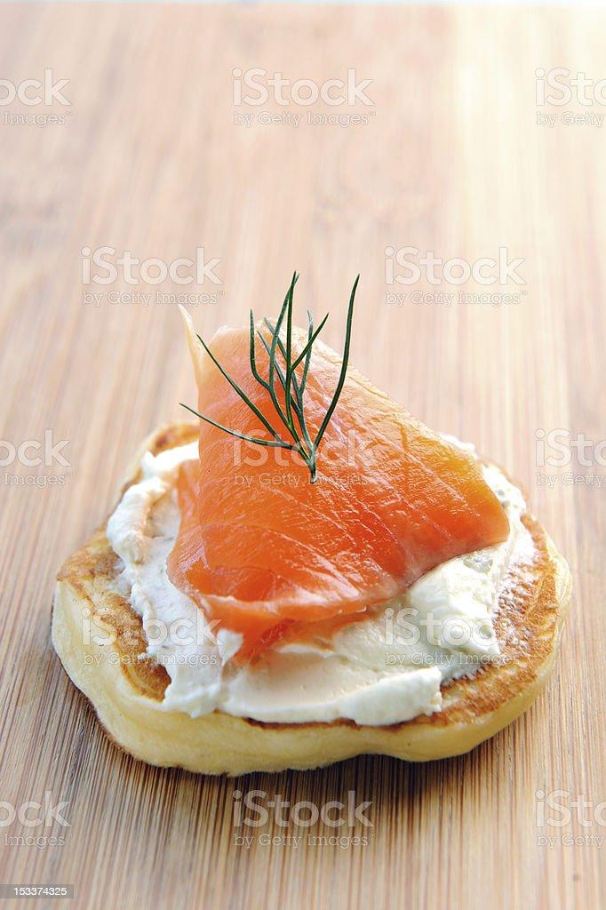 Single smoked salmon canape stock photo