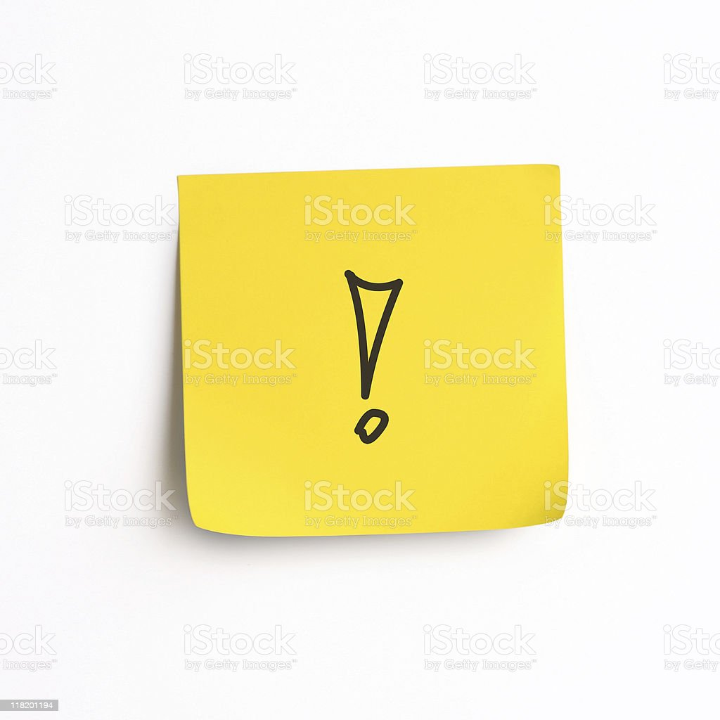 Single stick-on yellow note with an exclamation mark stock photo