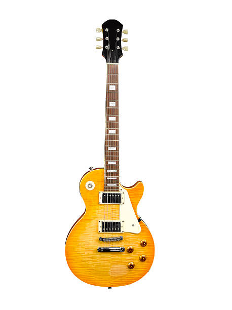 A single stood up electric guitar on a white background stock photo