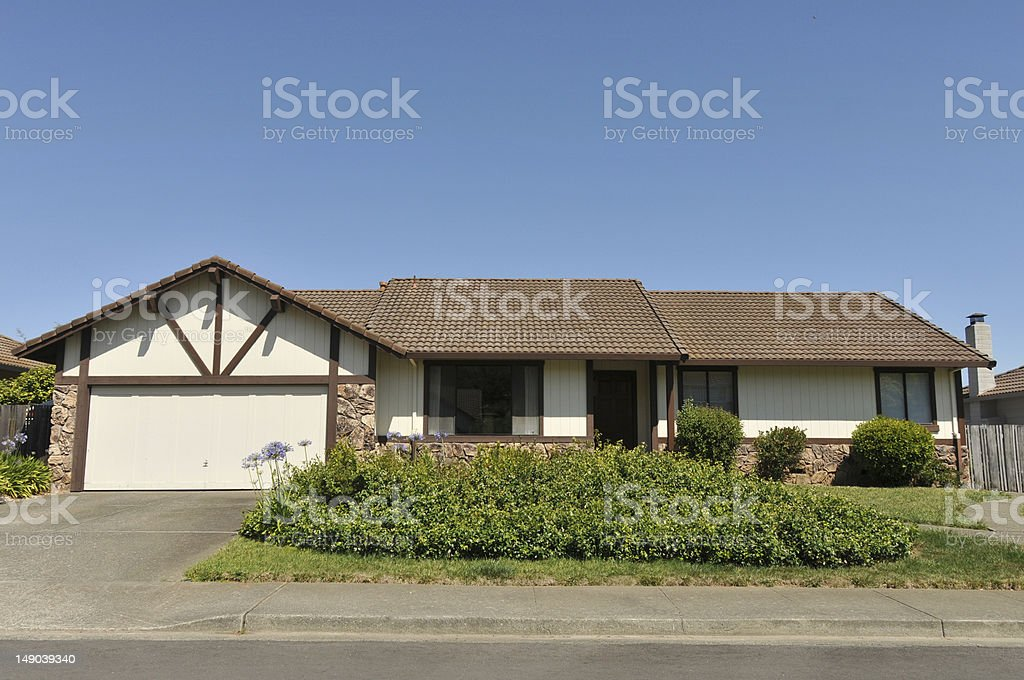 Single story family house with driveway royalty-free stock photo