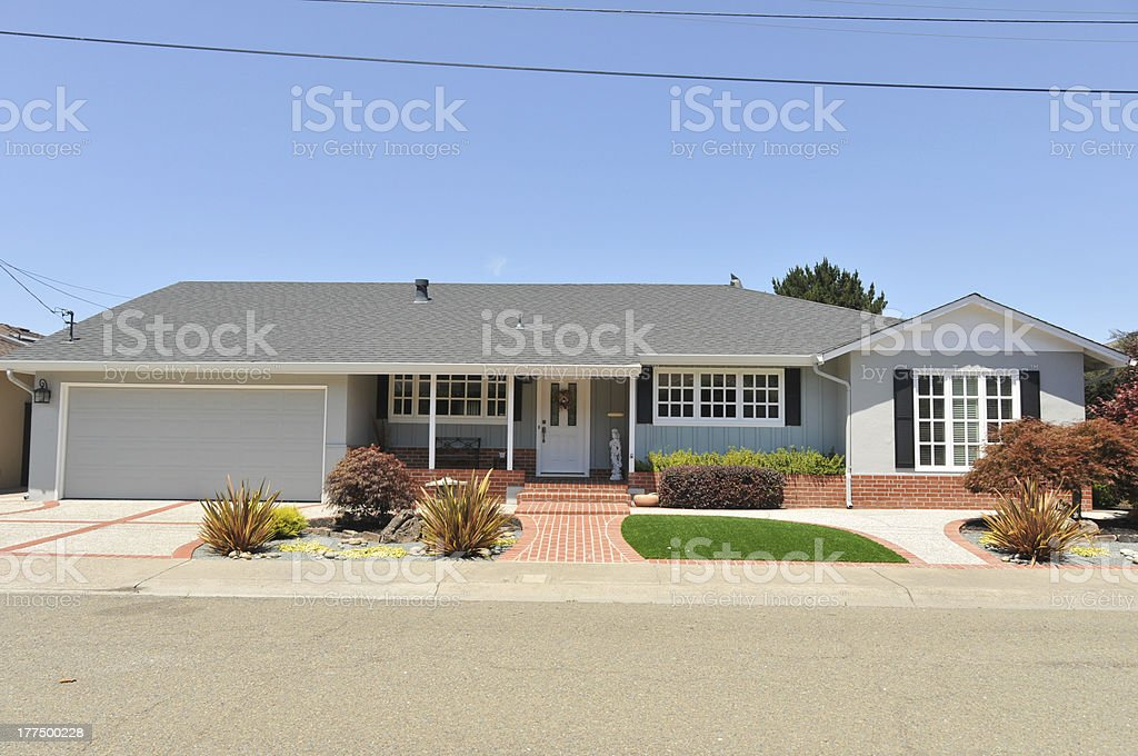 Single story family house with driveway stock photo