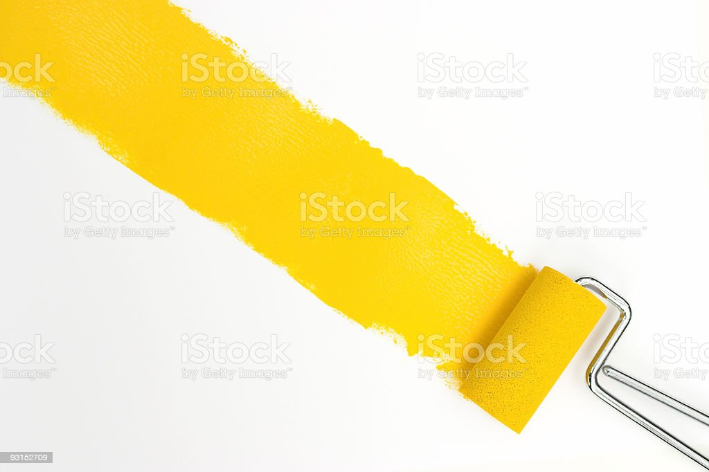 Single streak of yellow paint with rollers over white stock photo