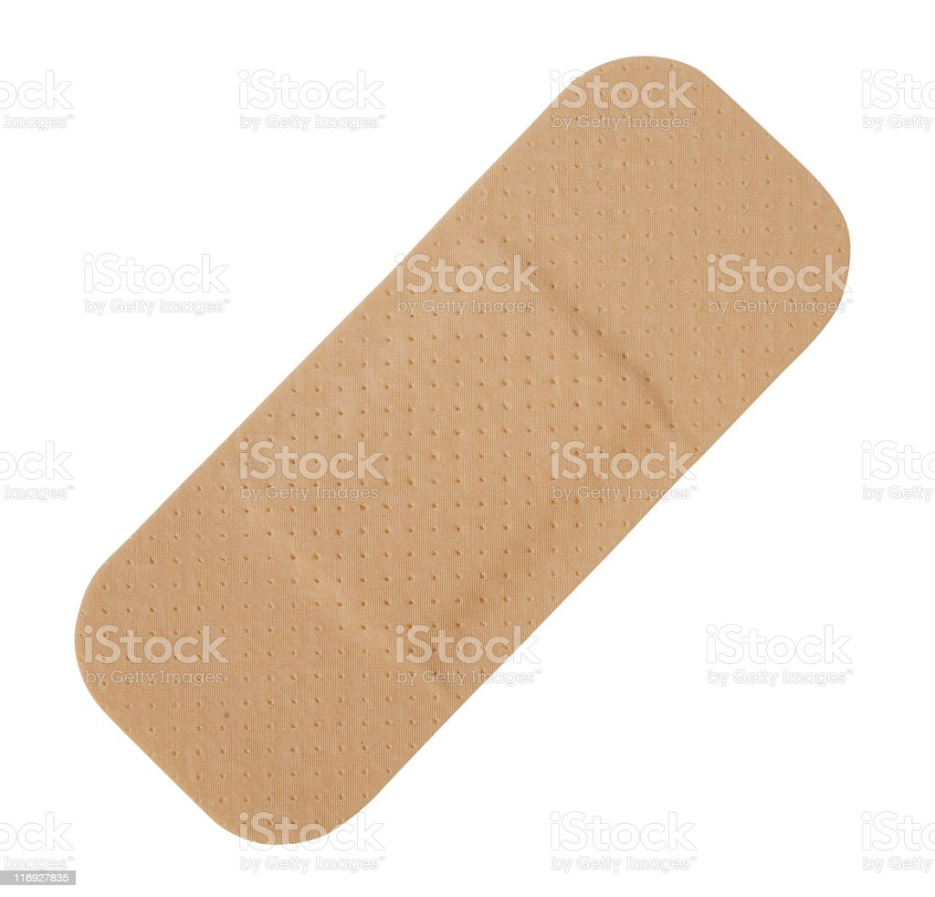 Single tan-colored Band-Aid on a white background stock photo
