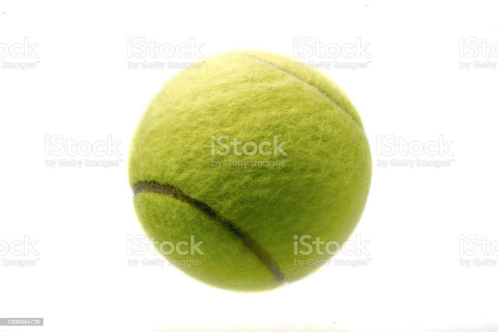 Single Tennis Ball on a white background stock photo