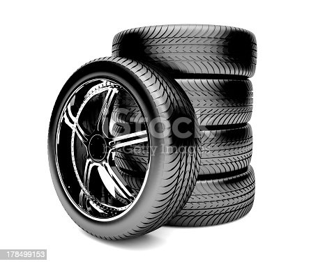496485590istockphoto Single tire laying against a stack of four tires 178499153