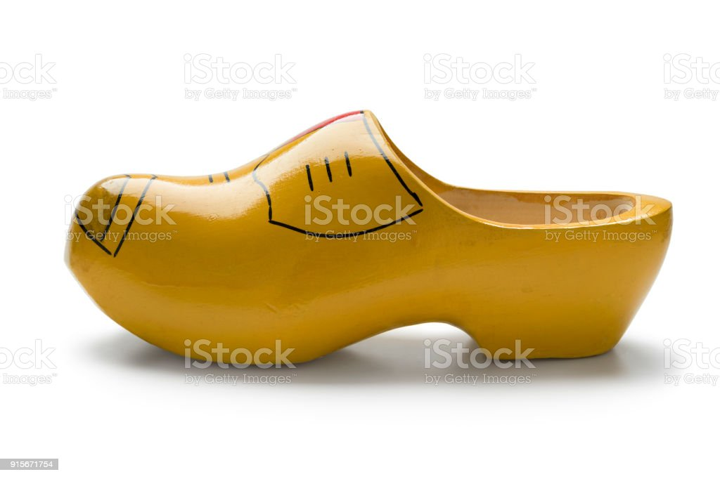 Single traditional yellow Dutch wooden shoe stock photo