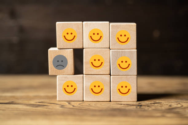single unhappy block and group of happy blocks - disbarment stock pictures, royalty-free photos & images