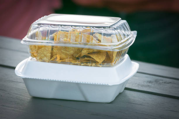 Single use plastic and Styrofoam food containers ready for take out from a restaurant. stock photo