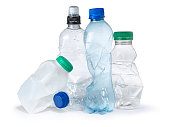 shot of a group of plastic bottles crumpled and discarded ready for the trash and landfill. the image highlights the environmental issues with waste disposal. cut out on a white background with copy space for the designer