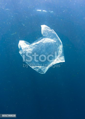 A single use Plastic bag floats in the Ocean.  Seemingly harmless, it represents the massive environmental issue that is Global Ocean Pollution.  Plastic in the Ocean is said to be one of the largest threats to our ocean ecosystems.  Over 8 million tonnes is dumped in the Ocean every year.  Discarded, abandoned or obsolete items which become dangerous garbage, is responsible for the deaths of huge amounts of Marine Life every year, through entanglement and consumption.  The location here is Phi Phi Islands, Krabi, Thailand.