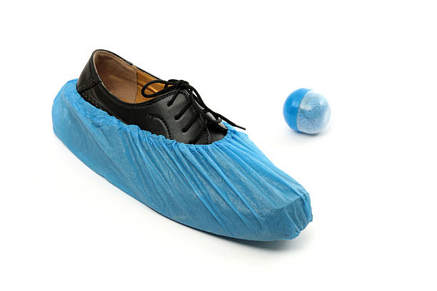 Single use shoecovers stock photo