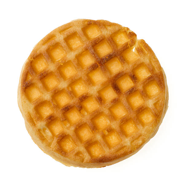 Single Waffle Single waffle isolated on white background--viewed from directly above. waffle stock pictures, royalty-free photos & images
