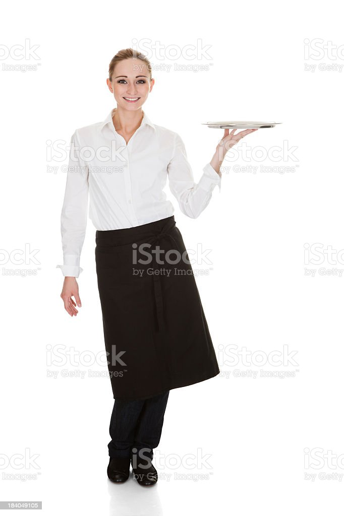 A single waitress posing while holding a tray stock photo